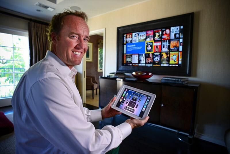 """Michael Fehmers, president of CBA Technology, shows off the very latest in smart home technology installed in a Taluca Lake home.  The system operates electronics throughout the house all from and iPad, iPhone or remote control.   (Photo by David Crane/Los Angeles Daily News.)"""